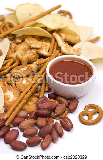 Salty snacks and salsa dip - csp2020329