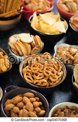 Salty snacks served in bowls - csp54070368