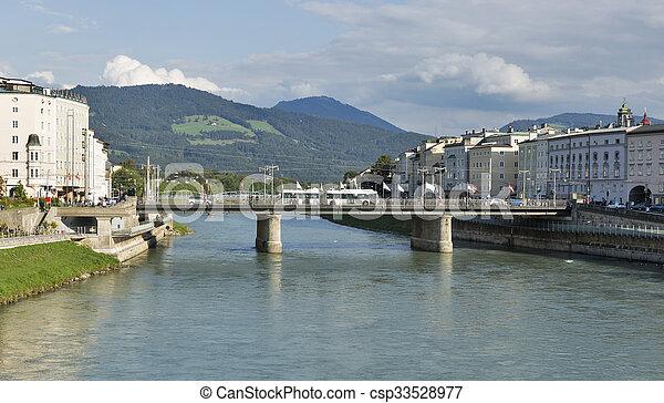Salzach river and Staatsbrucke bridge in Salzburg, Austria - csp33528977