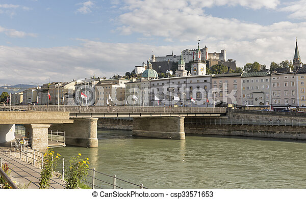 Salzach river, Staatsbrucke bridge and fortress in Salzburg, Austria - csp33571653