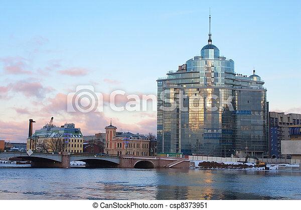 Sampsonievsky bridge and Modern building on Neva river in Saint-Petersburg, Russia - csp8373951