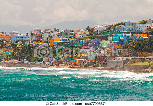 San Juan, Puerto Rico stays true to its heritage and shows off its vibrant culture with its colorful neighborhoods overlooking the ocean. - csp77995874