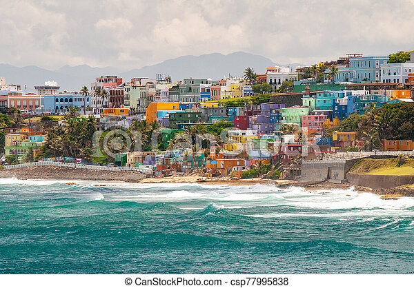 San Juan, Puerto Rico stays true to its heritage and shows off its vibrant culture with its colorful neighborhoods overlooking the ocean. - csp77995838