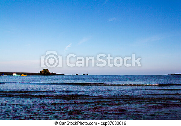 Sand and sea on the seafront at Bude, Cornwall - csp37030616