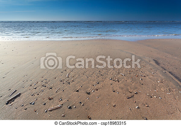 sand beach on North sea at low tide - csp18983315