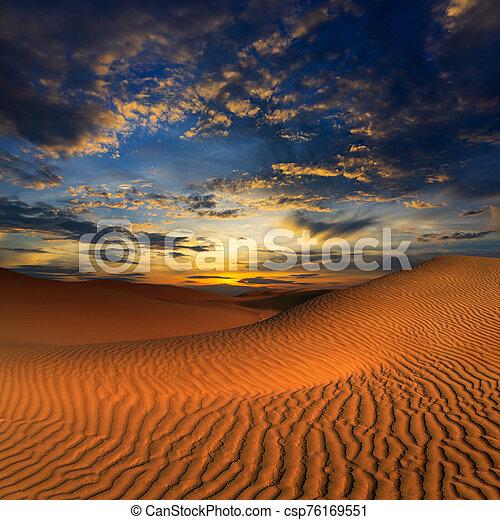 sand dunes in desert at sunset - csp76169551