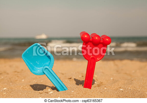 Sand toys on the beach of Lake . - csp63165367