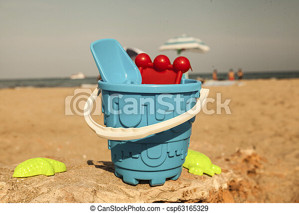 Sand toys on the beach of Lake . - csp63165329