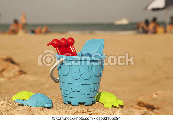 Sand toys on the beach of Lake . - csp63165294