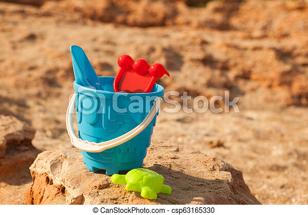 Sand toys on the beach of Lake . - csp63165330