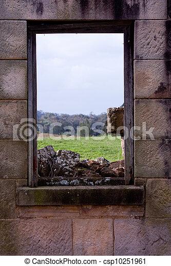 Sandstone window frame with field - csp10251961