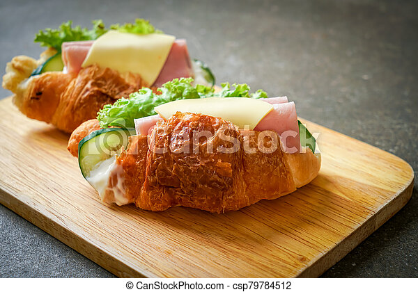 sandwich croissant ham cheese - csp79784512