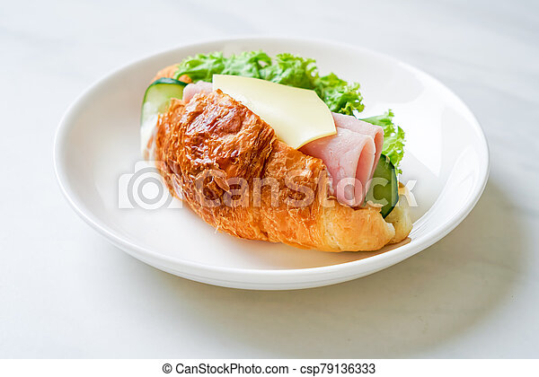 sandwich croissant ham cheese - csp79136333