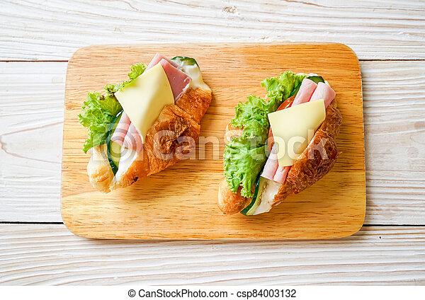 sandwich croissant ham cheese - csp84003132