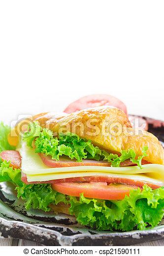 Sandwich croissant on white background - csp21590111