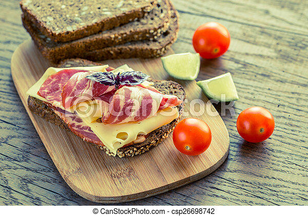 Sandwich with ham and cheese - csp26698742
