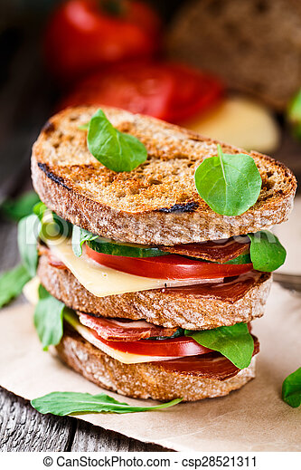 Sandwich with ham, cheese and vegetables - csp28521311