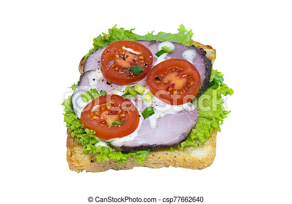 Sandwich with ham, lettuce and tomatoes. Isolated on a white background - csp77662640