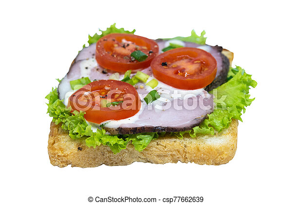 Sandwich with ham, lettuce and tomatoes. Isolated on a white background - csp77662639