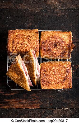 Sandwich with mozzarella and prosciutto - csp29439817