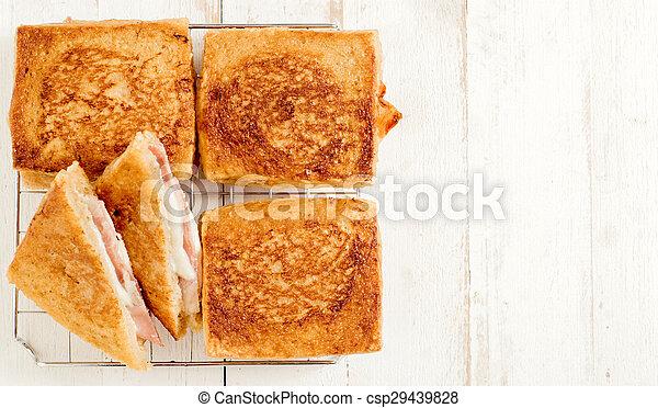 Sandwich with mozzarella and prosciutto - csp29439828