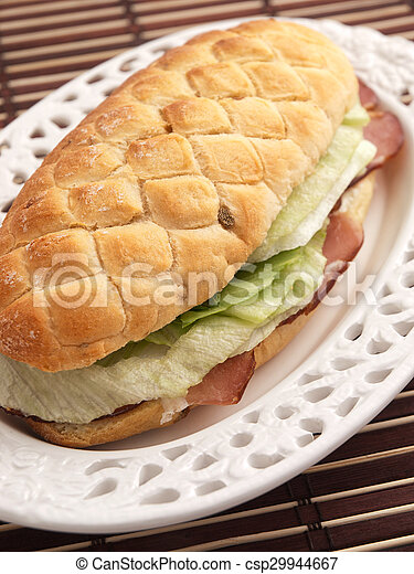 Sandwich with prosciutto and salad - csp29944667