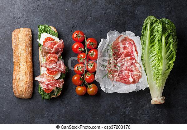 Sandwich with salad, prosciutto and mozzarella - csp37203176