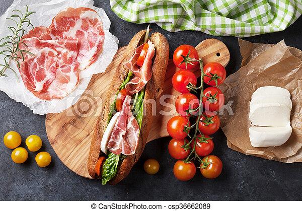 Sandwich with salad, prosciutto and mozzarella - csp36662089