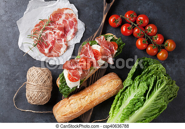 Sandwich with salad, prosciutto and mozzarella - csp40636788