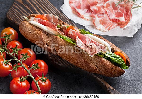 Sandwich with salad, prosciutto and mozzarella - csp36662156