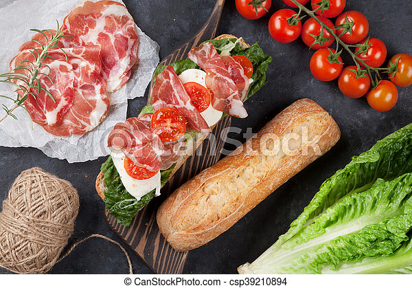 Sandwich with salad, prosciutto and mozzarella - csp39210894