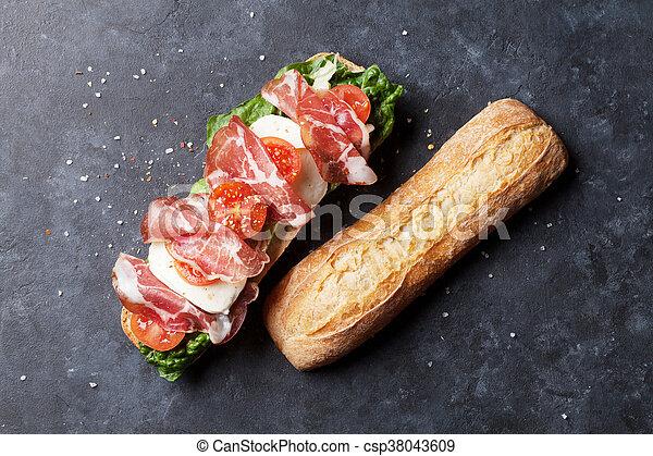 Sandwich with salad, prosciutto and mozzarella - csp38043609