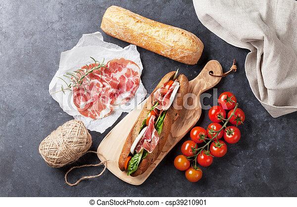 Sandwich with salad, prosciutto and mozzarella - csp39210901