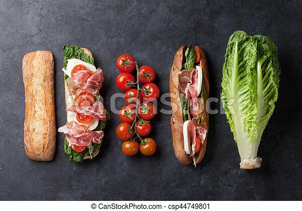 Sandwich with salad, prosciutto and mozzarella - csp44749801