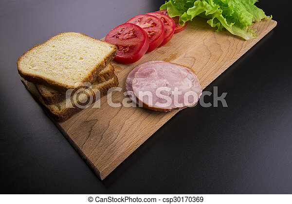 sandwich with tomato cheese and ham - csp30170369