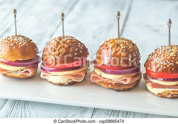 Sandwiches with cheese and ham on the plate - csp58665474