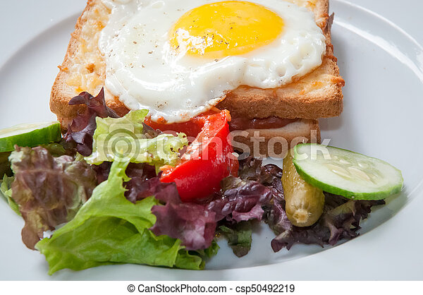 Sandwiches with white bread bacon and egg . - csp50492219
