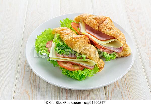 Sandwish croissant on wood - csp21590217