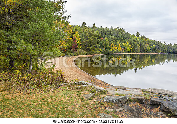 Sandy Beach on a Forested Lake in Autumn - Ontario, Canada - csp31781169