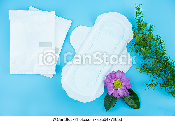 Sanitary napkin with flowers on blue background - csp64772656