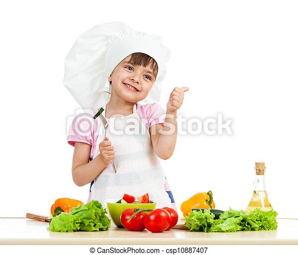 Chica Chef preparando comida sana sobre fondo blanco - csp10887407