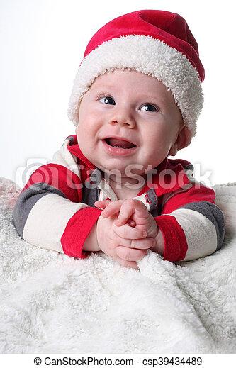 2dd78a63c9569 Santa baby. Christmas baby boy wearing a santa hat.