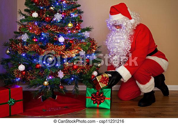 santa claus delivering presents under the tree csp11231216 - Santa Claus Presents