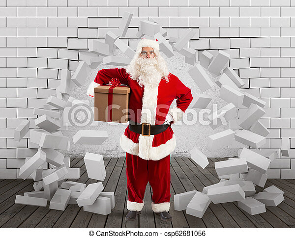 Santa Claus enters to deliver the gift by making a hole in the wall - csp62681056