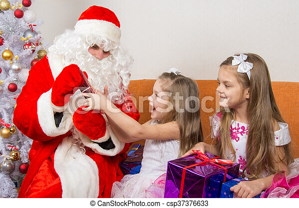 santa claus gives presents two sisters csp37376633 - Santa Claus With Presents