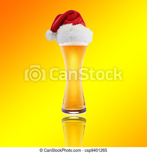 Santa Claus hat with beer on a yellow background - csp9401265