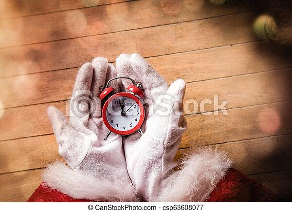 Santa Claus holding Chrstmas alarm clock - csp63608077