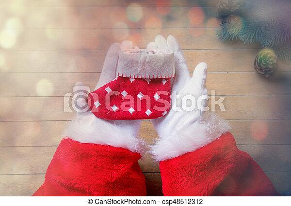 Santa Claus holding Chrstmas sock - csp48512312