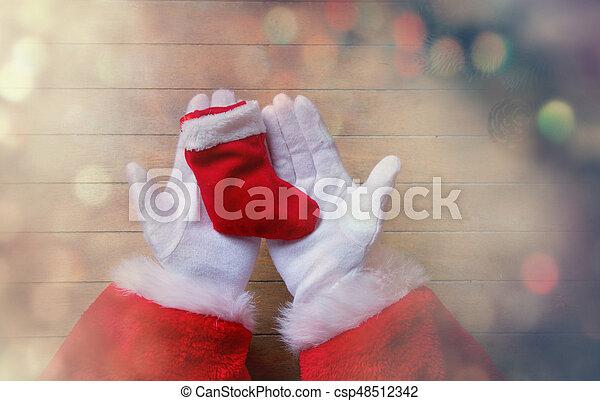 Santa Claus holding Chrstmas sock - csp48512342