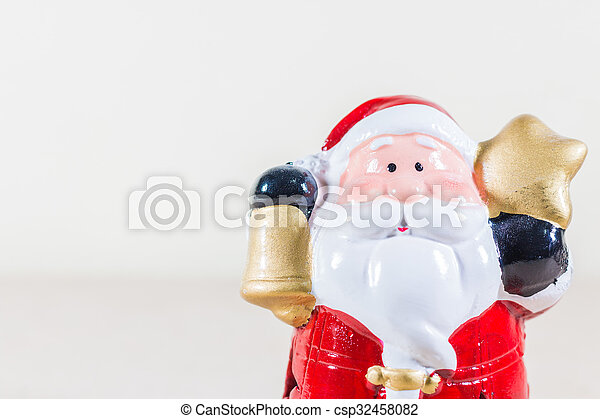Santa Claus Holding Gold Star and Bell - csp32458082